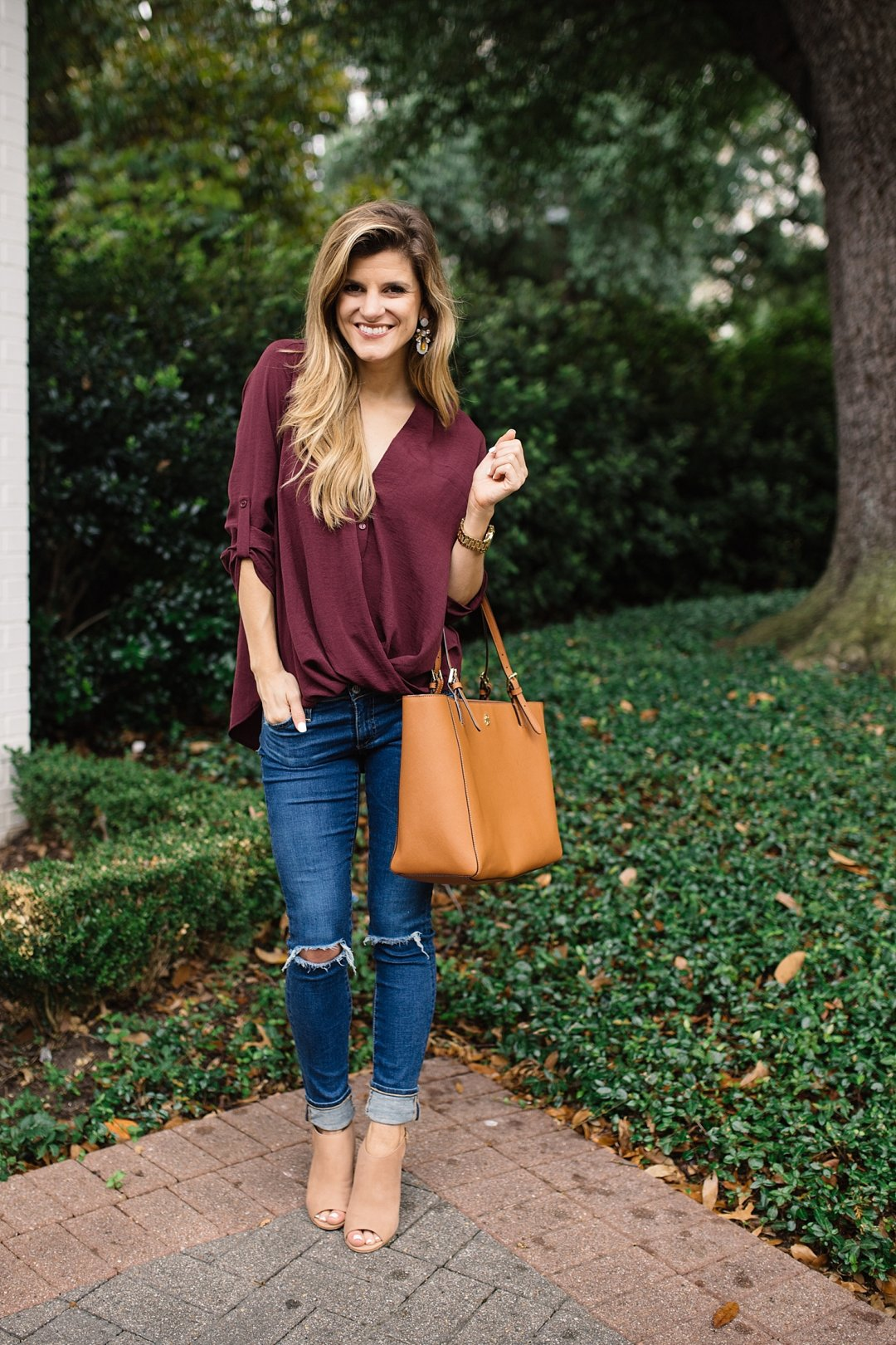 transition from summer to fall cute outfit idea with peep toe booties and versatile burgundy blouse